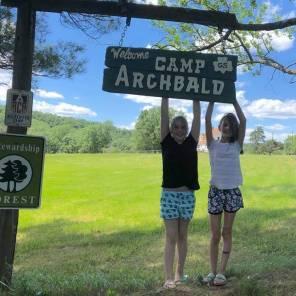 2-girls-at-ca-sign